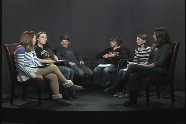 Students from O'Maley Middle School on the Cape Ann TV studio set